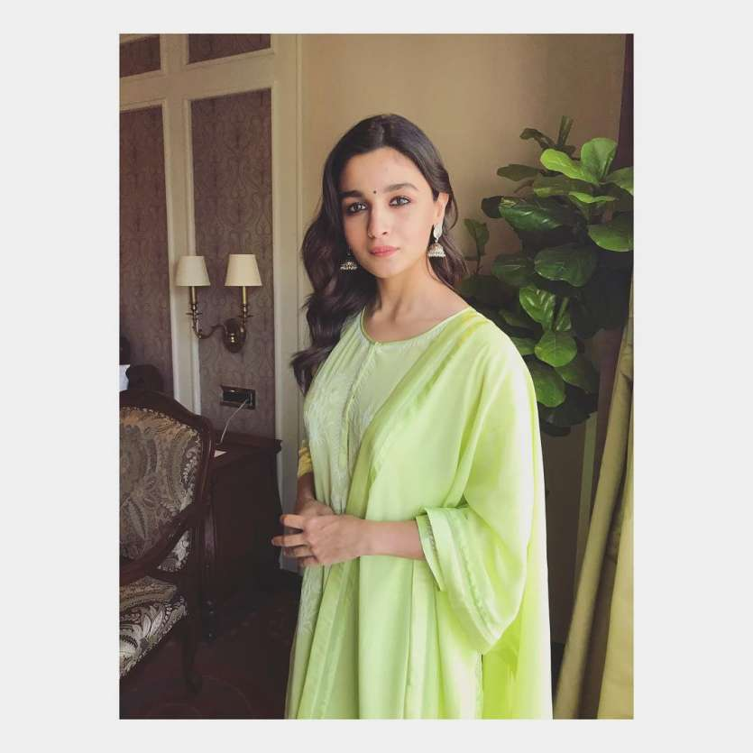 Dressed in a beautiful green suit, Alia completed her look with heavy jhumkas.