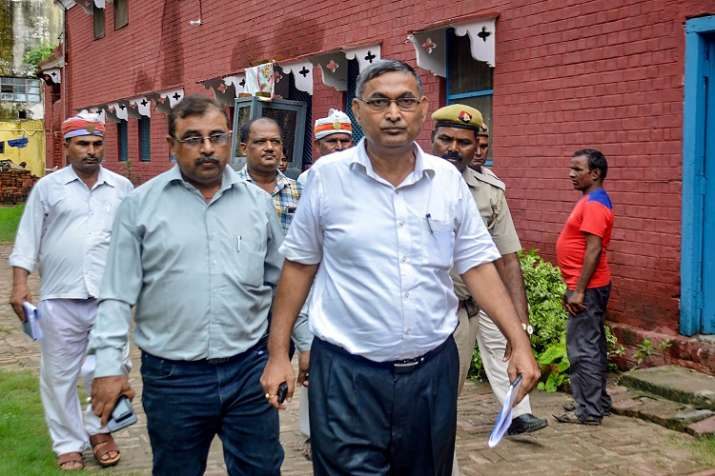 Officials arrives for an investigation, in Deoria on Monday.