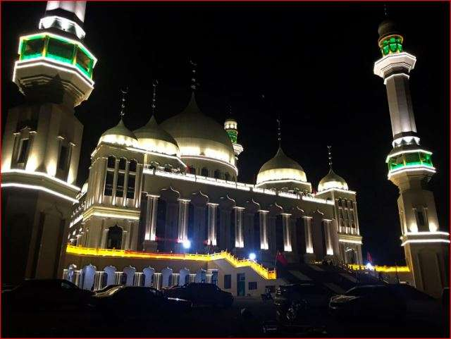 Vehicles are parked outside the Grand Mosque in Weizhou in