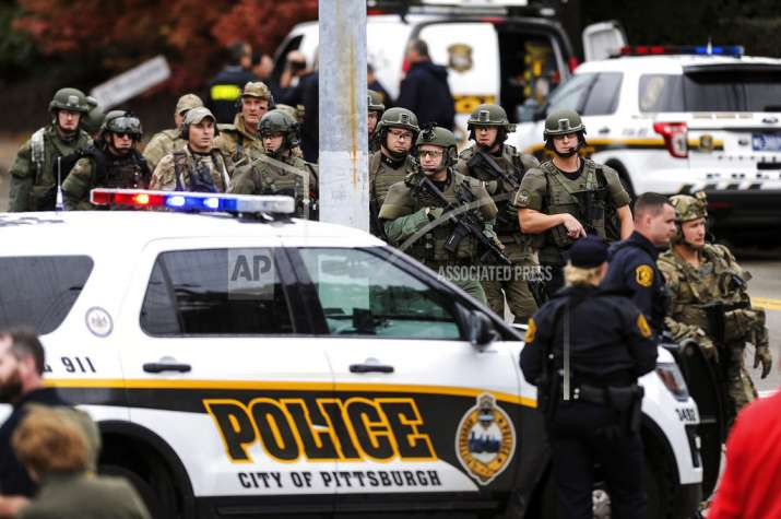 Law enforcement officers secure the scene where multiple