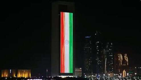 The flag of India displayed on the facade of the ADNOC