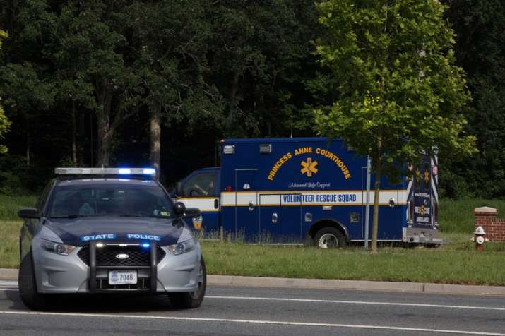 An ambulance turns on Nimmo Parkway following a shooting at