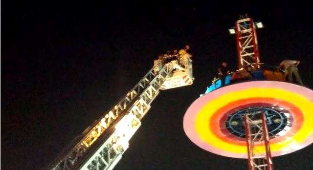 14 children among 40 rescued from tall merry-go-round