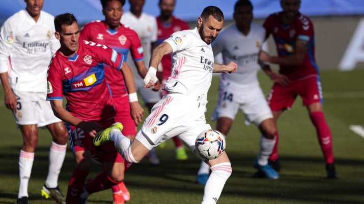 Benzema's late brace earned Madrid a 2-1 win over Elche