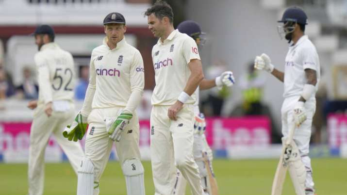 Pacer James Anderson, right, speaks to England's Jos Buttler