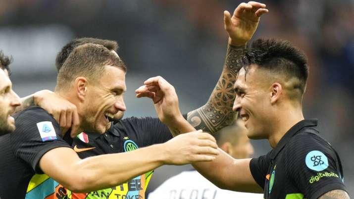 Inter Milan's Edin Dzeko, left, celebrates after scoring his side's 5th goal